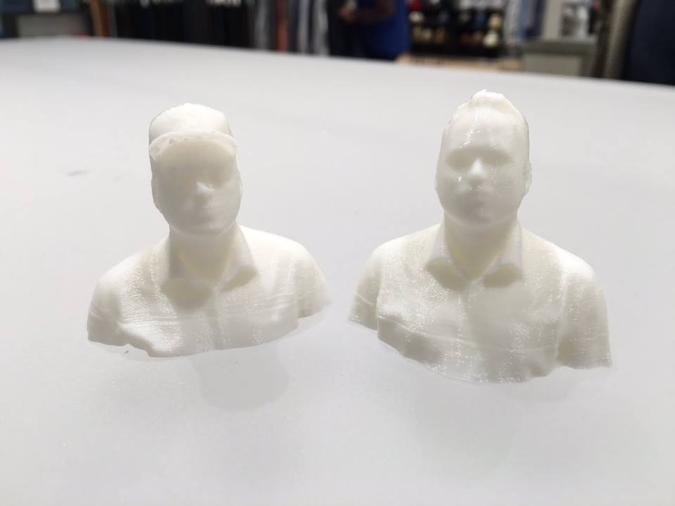 Two 3D printed copies of me, one with a ballcap, one without